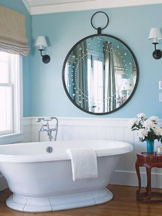 Blue Bathroom:   Wash away the winter blahs by adding a cool, bright blue to your bath. These walls are painted in Pratt  Lambert's Coos Bay.