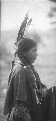 Spokane girl named Lizzie Boyd poses in ceremonial dress, 1907