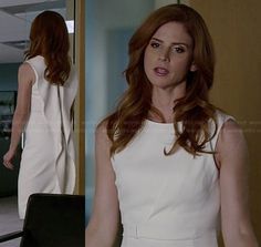 Donna's white dress with ruffle back on Suits