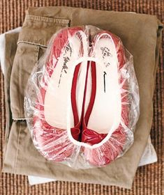 Shower Cap as Shoe Bag - Prevent dirt or sand-covered shoes from mingling (and soiling) neatly packed clothes in your suitcase.