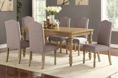 "7 pc Ophelia II collection natural finish wood dining table set with turned legs. This set includes the table and 6 side chairs with nail head trim and turned legs.  Table measures 44"" x 66"" x 30"" H. Side chairs measure 18"" x 24"" x 40"" H.  Some assembly required."