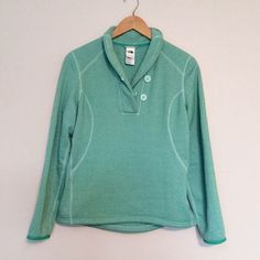 North Face Pullover Super cute sea foam green pullover. Warm fleece inside. Size medium but would also comfortably fit a small. Never worn! North Face Tops Sweatshirts & Hoodies
