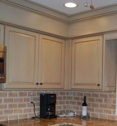 Kitchen Cabinet Remodel Hide kitchen soffit with molding and crown molding. Kitchen Soffit, Above Kitchen Cabinets, Kitchen Cabinet Remodel, Painting Kitchen Cabinets, Kitchen Paint, Kitchen Redo, New Kitchen, Kitchen Ideas, Cupboards