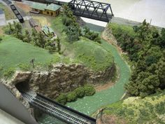 "https://flic.kr/p/8Sn2k6 | Nscale Model Train Layouts | Custom built fine quality  Nscale, Z scale and, HO scale layouts by ""Rasch Studios""    This layout went to New Jersey    Future projects include an Nscale Pennsy four track mainline circa 1958 to 1968 with scenic river side running, and a full yard.  , A  Z scale Lord Of The Rings inspired layout with dramatic three foot deep canyons and trestles, and last but ot least an HO scale western mining town layout."