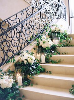 Elegant floral lined stairway: http://www.stylemepretty.com/florida-weddings/lake-buena-vista-florida/2016/06/30/youve-got-to-see-this-staircase-ceremony/ | Photography: Kayla Barker Fine Art Photography - http://www.kaylabarker.com/