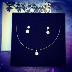 Silver earings and neckles from Wedding Art by Magda Purchla