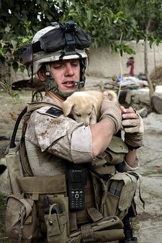A marine with a puppy in Afghanistan