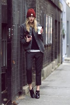 COS bomber jacket, an H knit layered over an Isabel Marant mesh top, Tibi windowpane pants, and a Clare Vivier x Moda Operandi pouch. The black booties are Elin Kling x Marciano