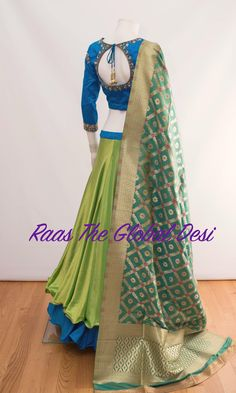 Color : parrot green,blueFabric :silk Occasion : WeddingOccasion : PartyWork : zari,handwork Silk layered chaniya with stone and zari work blouse and banarasi dupatta skirt length is 41 inches approx For any query CALL : 630 407 7419 Half Saree Designs, Choli Designs, Lehenga Designs, Blouse Designs, Half Saree Lehenga, Lehenga Gown, Indian Wedding Outfits, Indian Outfits, Designer Lehanga