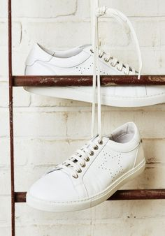 A simple white trainer is a must for work-to-weekend style. And this season, we've designed our own pair.