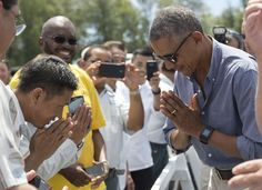 President Barack Obama bows as he greets workers and volunteers at Henderson Field on Midway Atoll, Sept. 1, 2016.