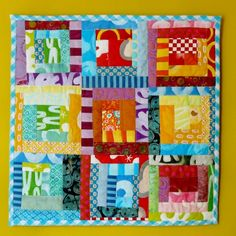 Another quilt from a French site - a small lob-cabin quilt. I like that the logs are still straight (and not totally wonky) but that they vary in size and placement slightly from the traditional Log Cabin block layout.