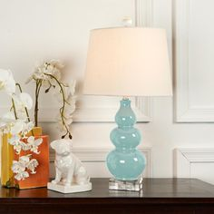 This comes in turquoise, sea green, and navy.  I like it a lot!  The price is reasonable - $189.  I would place it on a side table by the sofa, or the chest by the stairs, if we keep it.    Triple Gourd Mini Lamp on Clear Crystal Base