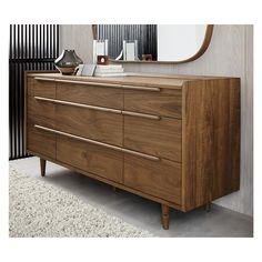 Shop Tate 9-Drawer Dresser. The horizontal dresser presents a continuous front with nine drawers of varying size. Designed by Blake Tovin, the Tate 9-Drawer Chest is a Crate and Barrel exclusive.