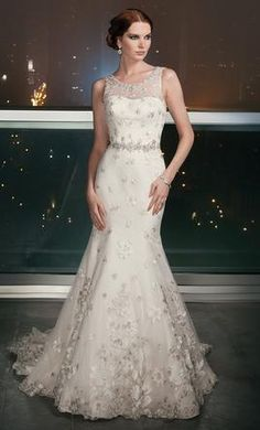 Justin Alexander Signature 9703: buy this dress for a fraction of the salon price on PreOwnedWeddingDresses.com