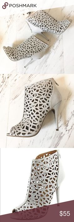 NWT    Zigi Soho Drift High Heel, Silver The Zigi Soho Drift peep toe bootie is the perfect pair of heels to dress up your look. With stunning caged styling and rhinestone embellishments; these eye catching cutout ankle boots will take your evening attire up a notch. Comes with tags and a few extra sparkles in case any fall off. These are new in box, but I don't have the box top any longer. Zigi Soho Shoes Ankle Boots & Booties