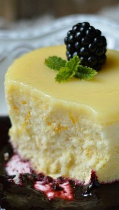 Meyer Lemon Pudding Cakes with Blackberry Sauce . yummmm