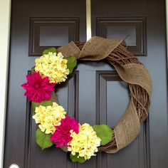 DIY spring wreath.... different flowers, but I like the burlap