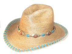 "One of a kind Custom Hand-Made Palm Leaf Cowboy hat by Rose Arland Collection.    4""  Brim, 5 ¼""  Crown-  Copper Green lace   leather Whip-stitch Trim.    Hand-made Hat Band adorned with Gemstone Pendant , Swarovski Crystals , copper,  and  antique beads.    Size  7- 3/8 ""  $325.00"