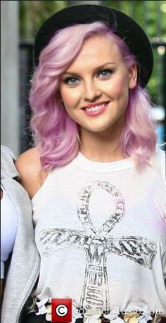 This is the 'Youtube Tutorial' project we did, and I changed Perrie's hair color from white blonde to pink/lavender-ish. First I found a picture I liked, in this case, a picture of Perrie. I changed the blending mode to 'overlay'. Then, I added a new layer, and picked a color I like and painted it over the area that was her hair. I changed the blending to 'overlay' too. This is it, so it was sorta an easy tutorial, but I like how it turned out. My inspiration is from Aly Antorcha's hair.