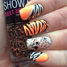 "Animal print with an accent nail of Maybelline street artist ""Urban Vibe"" - -@Deanne Wright"