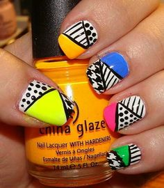 Black & white patterned nail art with a slash of color