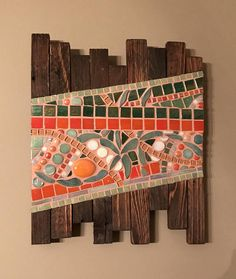 This piece is made from reclaimed pallet wood and glass mosaic tiles. The colors include various shades of green and orange along with some white. It is finished with an orange tinted grout. The dimensions are Hanging hardware is included. Wood Mosaic, Mosaic Wall Art, Glass Mosaic Tiles, Tile Art, Mosaic Mirrors, Mosaic Crafts, Mosaic Projects, Mosaic Designs, Mosaic Patterns