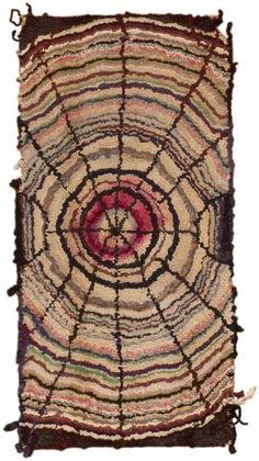 Created in North America, this delightful vintage hooked rug depicts a marvelous spider web pattern comprised of stratified outlines arranged in a concentric pattern.