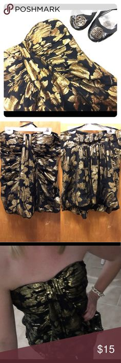 Gorgeous Bebe Strapless Top The cutest strapless top! It has beautiful bright gold detailing. Sad to see this one go but I have so many tops in my closet and it's time to give this one a new home ✅Bundle and SAVE ❌ Sorry, no trades 🚛 Fast shipping  👍🏼 Offers on items over $10 🚫Smoke and pet free home 💟 Happy Poshing! bebe Tops