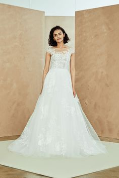 """Miranda by Nouvelle Amsale"" Tulle ball gown with hand appliqué embellished lace with illusion neckline and cap sleeves"