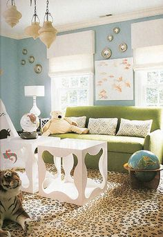 Celerie Kemble green sofa with pale blue walls