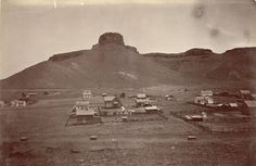"""~1871 in Golden Colorado~ View of a portion of the town of Golden (Jefferson County), Colorado. Castle Rock is nearby on South Table Mountain. Is Part Of C Photo Collection 254. W. G. Chamberlain photograph collection.  Source: Early """"Scrap"""" book of Denver and Colorado given by the family of William G. Chamberlain, Photographer, 1861-1881. Western History/Genealogy Dept., Denver Public Library."""