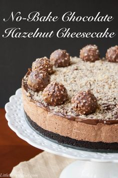 Only 4 ingredients, no-baking, simply mix, chill  VOILA! Oreo cookie crust with a chocolate hazelnut cheesecake filling, topped with a chocolate hazelnut spread and decorated with Ferrero Rocher candies. This is the EASIEST and most DELICIOUS cheesecake you will ever make.