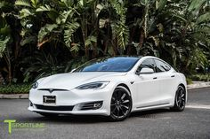Pearl white Tesla model S with 19 inch matte black rims by T Sportline.