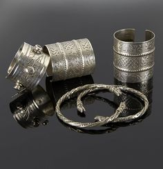 Tunisia   Pair of ring like anklets and three cuff bracelets (one a matching pair). Silver   868€ Sold ~ (May '15)