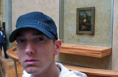 The Eminem Standing in Front of the Mona Lisa. 32 best selfies of all time.