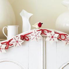 diy snowflake garland-  This is so pretty!  From We All Sew, there's a lot of cute ornament ideas here... great for gifts!!