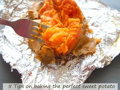 In the foreground, a fork with part of the pulp of the baked sweet potato. In the background, a baked sweet potato slit longitudinally and some of the skin peeled away to reveal the baked pulp - 5 Tips on Baking The Perfect Sweet Potato Sweet Potato Recipes, Veggie Recipes, Cooking Recipes, Healthy Recipes, Baked Sweet Potato Oven, Grilled Sweet Potatoes, Oven Baked, Healthy Meals, Yummy Recipes