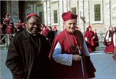 Bishop Karol Wojtyla walking in St. Peter' Square with an african bishop, during the 2nd. Vatican Council.  1962.