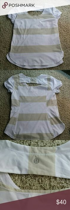 Lululemon top striped Lululemon striped top on cashew and white. Super cute, slinky material.  Not sure what the name. Size 8. Smoke and cat free home.  Never worn. lululemon athletica Tops Tees - Short Sleeve