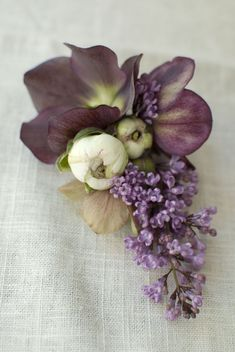 Mother of the bride corsage: Hellebore, ranunculus and lilac