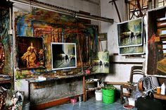 Chinese Art Studio    This is a typical art studio factory in Southern China, mass producing reproduction copies of classic works of art and oil paintings for export.   The artists producing these paintings come down from the North of China to southern China in search of work and live in cramped conditions 3 or 4 to a room and sleep, cook, eat and paint in the same room.