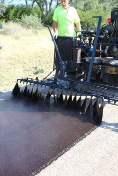 Chip and Seal being installed: Spray bars are spraying out hot-tar and we will come by with Washed Stone. Asphalt Pavement, Road Construction, Cirebon, Tx Usa, Rv Interior, Calendar Design, Driveways, Heavy Equipment, Evening Gowns