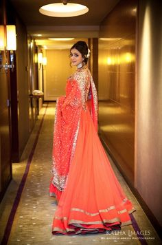 love this tangerine outfit and the way she is draping the dupatta across herself!