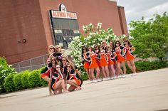 Seniors in front rest of team in back, maybe let seniors have Pom poms too but make sure it doesn't distract!