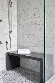 FREESTANDING BENCH, OPEN BELOW!Contemporary bathroom shower is filled with white grid marble tiles lined with a freestanding gray quartz waterfall shower bench placed atop a gray hex shower floor. Shower Seat, Shower Floor, Shower Benches, Shower With Bench, Shower Towel, Diy Shower, Shower Tub, Bad Inspiration, Bathroom Inspiration