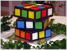 rubik's cube cake. I cannot believe how many AMAZING cakes and cupcakes are on Pinterest. How in the world do these artists make these? This is art in such a cool way. Imagine seeing the reaction of the person receiving these cakes? This looks so real!