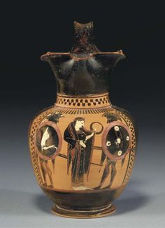 AN ATTIC BLACK-FIGURED OINOCHOE CIRCA 520 B.C.