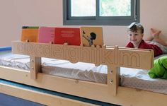 Innovate use of bed rail to store kids books! A headboard could do the same thing!