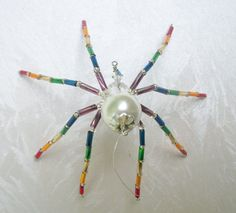 Rainbow Glass Beaded Spider Ornament by Thespiderlady on Etsy, $7.00